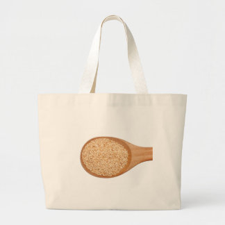 Spoonful of toasted sesame seeds large tote bag