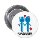 SPOONING LEADS TO FORKING PINBACK BUTTON