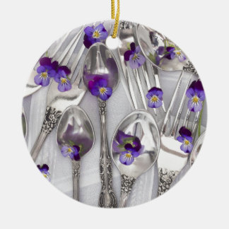 spoons and forks with violets ceramic ornament