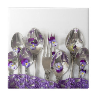 spoons and forks with violets ceramic tile