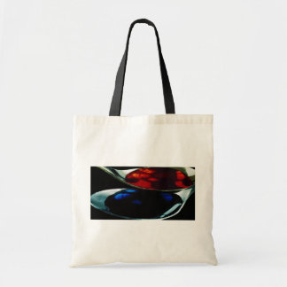 Spoons with blue and red liquid tote bags