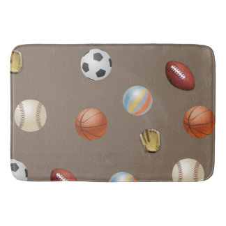 Sports ball's on a bath mat