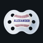 """Sports Personalized Baseball Pacifier<br><div class=""""desc"""">The perfect design for the budding sports fan! Design features a close up graphic of a baseball with red stitching. Inside the white part of the baseball is a place to personalize this Sports Personalized Baseball Pacifier with your baby's name in blue font.</div>"""