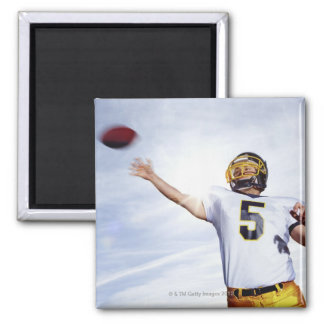 sportsman playing with rugby ball 2 inch square magnet
