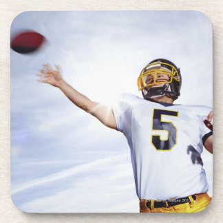 sportsman playing with rugby ball coaster