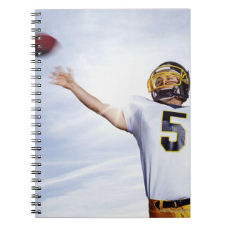 sportsman playing with rugby ball note book