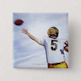 sportsman playing with rugby ball pinback button