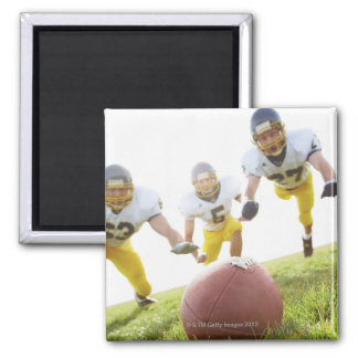 sportsmen playing with a rugby ball 2 inch square magnet