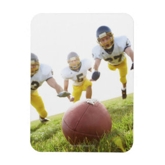 sportsmen playing with a rugby ball rectangular photo magnet