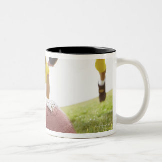 sportsmen playing with a rugby ball Two-Tone coffee mug