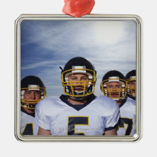 sportsmen standing together with sky in metal ornament