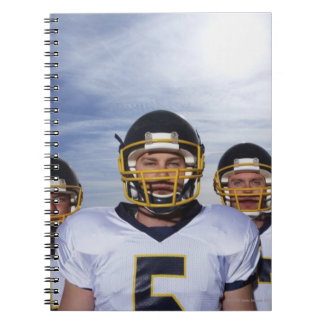 sportsmen standing together with sky in notebook
