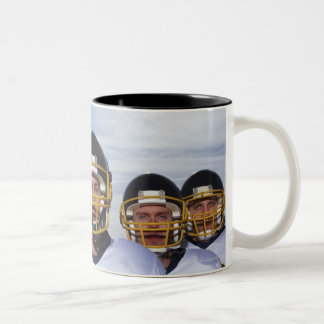sportsmen standing together with sky in Two-Tone coffee mug