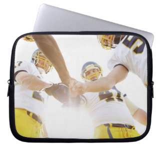 sportsmen standing with hands together laptop computer sleeve