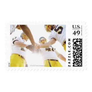 sportsmen standing with hands together postage stamp