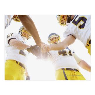 sportsmen standing with hands together postcard