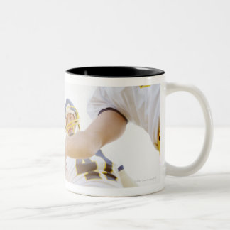 sportsmen standing with hands together Two-Tone coffee mug