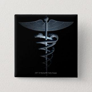 Spotlight on a medical caduceus pinback button