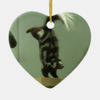 Spotted skunk; museum exhibit ceramic ornament