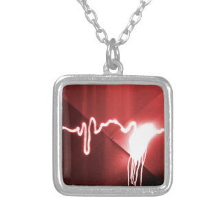 Sprayed graffiti on red metal silver plated necklace