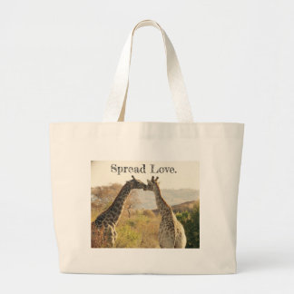 Spread Love tote with giraffes kissing image