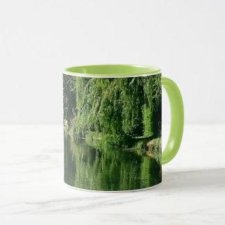 Spring day river walk pretty greenery and water mug
