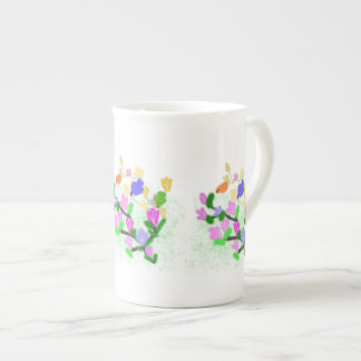 spring flowering branch and colorful  birds tea cup