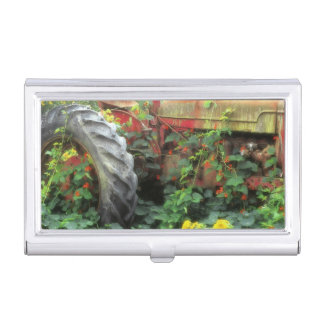 Spring flowers adorn an old tractor. business card case