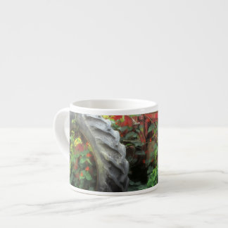 Spring flowers adorn an old tractor. espresso cup