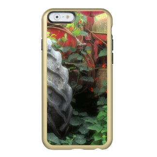Spring flowers adorn an old tractor. incipio feather shine iPhone 6 case