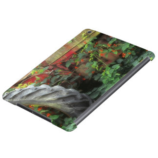 Spring flowers adorn an old tractor. iPad air covers