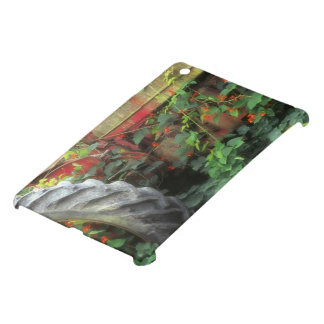 Spring flowers adorn an old tractor. iPad mini cases