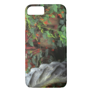 Spring flowers adorn an old tractor. iPhone 7 case