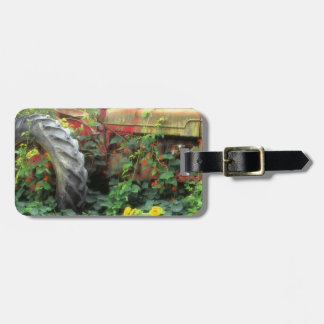 Spring flowers adorn an old tractor. luggage tag