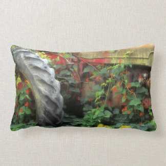 Spring flowers adorn an old tractor. lumbar pillow