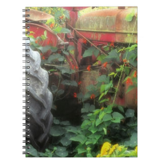 Spring flowers adorn an old tractor. notebook