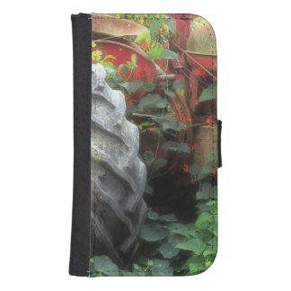 Spring flowers adorn an old tractor. samsung s4 wallet case