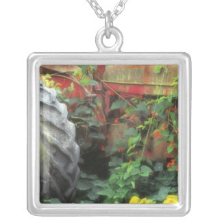 Spring flowers adorn an old tractor. silver plated necklace