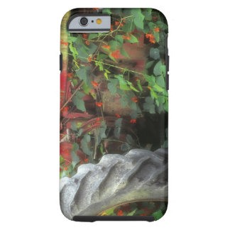 Spring flowers adorn an old tractor. tough iPhone 6 case