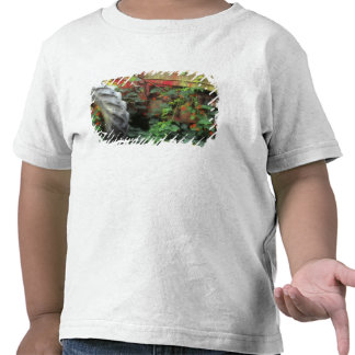 Spring flowers adorn an old tractor. tee shirts
