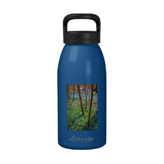 Spring meadow with blue flowers glory-of-the-snow water bottle