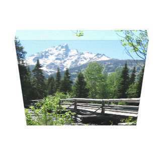 Spring Snow on Grand Tetons with Bridge over River Canvas Print