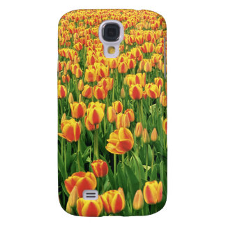 Spring tulips bloom in front of old barn. samsung s4 case
