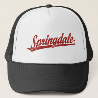 Springdale script logo in red distressed trucker hat