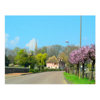 springtime French Countryside village with purple Postcard