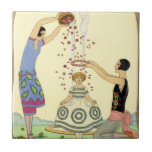 """Springtime in France Art Deco Tile<br><div class=""""desc"""">Springtime in France Art Deco tile. Spring (Le Printemps) Art Deco Illustration by Georges Barbier. One of Georges Barbier's lovely season illustrations. Spring features two young lovely women in art deco fashion dressing a little flower girl in rose petals and a flower crown in front of a streaming fountain. A...</div>"""