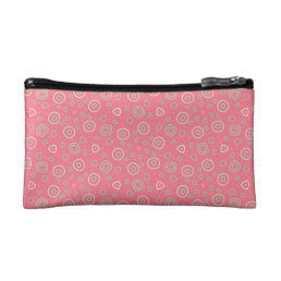 Sprinkles dot random shapes on rose pink makeup bag