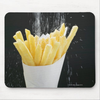 Sprinkling salt on chips in paper cone mouse pad