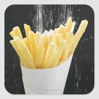 Sprinkling salt on chips in paper cone square sticker