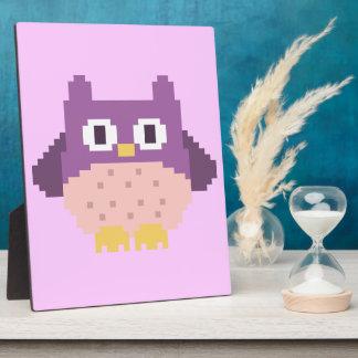 Sprite de 8 bits del búho del pixel placas con fotos